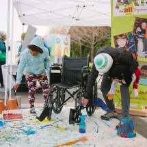 Kids painting with banner behind
