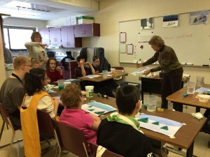 Rhonda Estes shares her watercolor skills with students at East Middle School