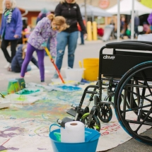 Wheelchair and other kid painting