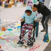 Wheelchair art kid being pushed