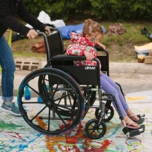 Wheelchair art little kid being pushed