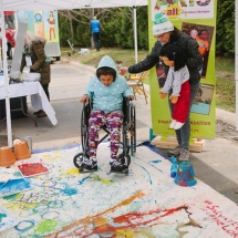 Wheelchair art with banner behind
