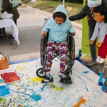 Wheelchair art with puppet and banner