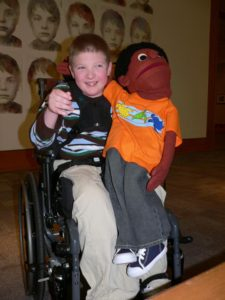 kid with puppet