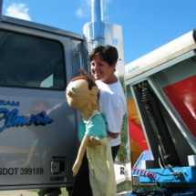 Dayna with puppet on truck