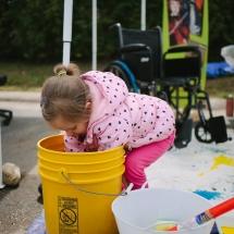 Kid reaching into bucket