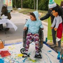Wheelchair art kid laughing