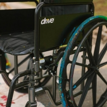 Wheelchair with paint-covered wheels