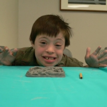 kid with clay